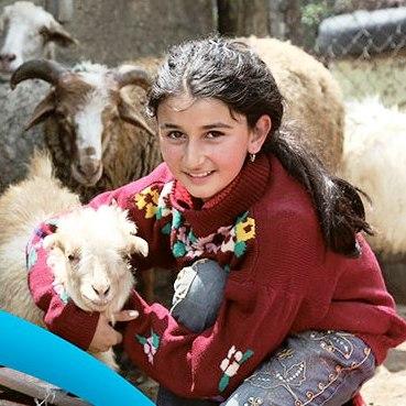 Mädchen mit Ziegen